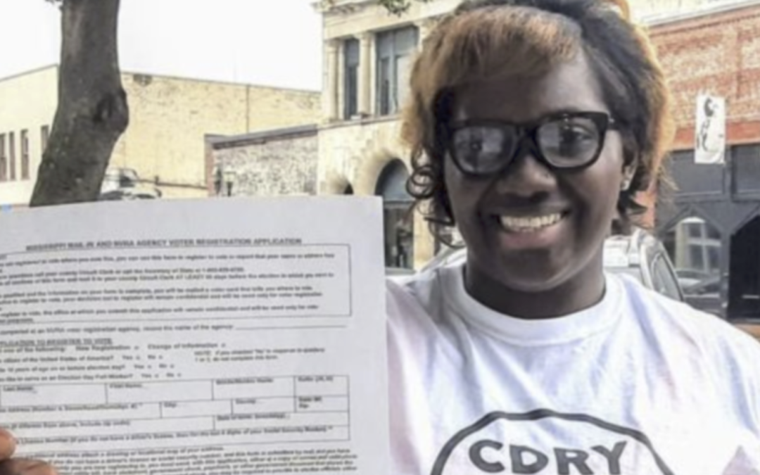 Upset with elected officials after COVID-19 halted her business, woman registers people to vote